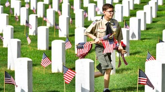 Placing flags on the graves at Nashville National Cemetery