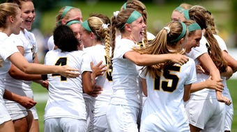 See Lansing Christian celebrate its state title and hear comments from coach Joel Vande Kopple and Kasey Jamieson following a 1-0 win.