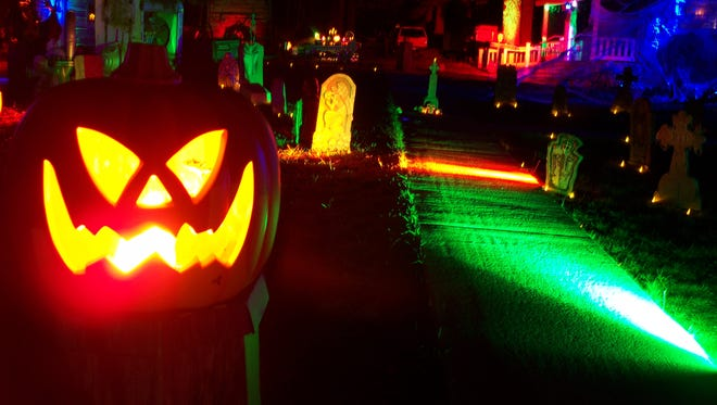 A scary jack-o-lantern lights the night at Haunted Village at Pioneer Village in Cloudcroft.