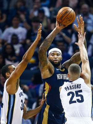 New Orleans Pelicans forward DeMarcus Cousins (middle) makes a pass around the Memphis Grizzlies defense during first quarter action at the FedExForum in Memphis, Tenn., Wednesday, October 18, 2017.