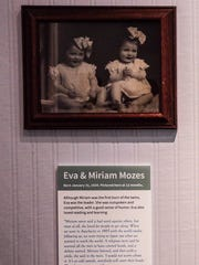 A photo of Eva and her twin sister Miriam is part of a display at the CANDLES museum in Terre Haute, Ind.