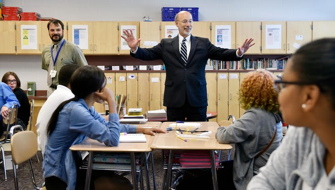 Gov. Tom Wolf encourages Ferguson eighth-grade students to continue studying during a visit in September. Wolf announced Thursday that the state has until June 6 to comply with federal standards regarding state IDs.