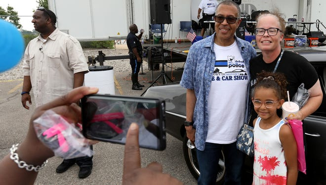 "Chief James E. Craig of the Detroit Police Department has his picture taken with Heidi Hesser, 44 of Canton and Ella Rosenthal, 6 of Detroit during the ""Showdown in Motown Bike and Car Show Extravaganza."""