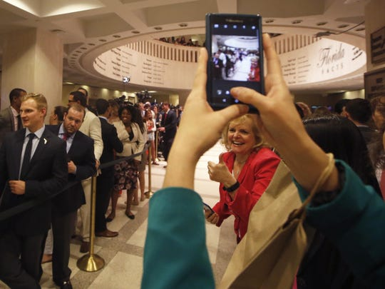 People celebrate Sine Die at the Capitol, signaling the end of the year's legislative session on Friday, March 11, 2016.