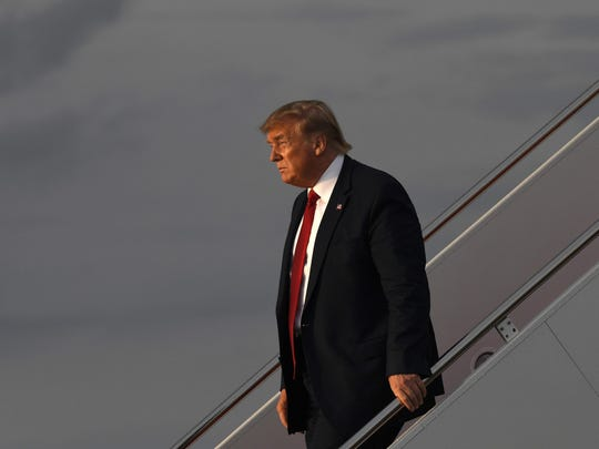 In this Aug. 21, 2019 photo, President Donald Trump walks down the steps of Air Force One at Andrews Air Force Base in Md. Trump is returning from Louisville, Ky., where he spoke to the American Veterans (AMVETS) 75th National Convention. A new poll finds about 6 in 10 Americans disapprove of President Donald Trump's overall job performance. The poll released Thursday by The Associated Press-NORC Center for Public Affairs Research finds some support for the president's handling of the U.S. economy, but it gives him weak marks on other major issues. Just 36% of Americans approve of the way Trump is handling his job as president, and 62% disapprove. Among Republicans, nearly 8 in 10 approve of his overall job performance.(AP Photo/Susan Walsh)