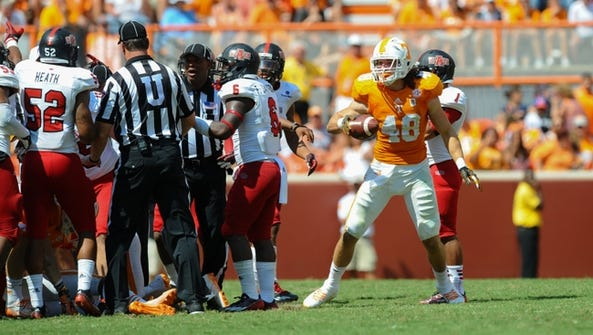 Tennessee tight end Alex Ellis (40) after recovering