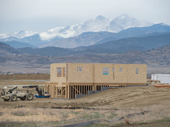 A home sits under construction at Heron Lakes in Berthoud. Average home prices in Berthoud rose 12 percent last year to $448,314. Prices are expected to remain about flat this year, according to The Group Real Estate's annual forecast.