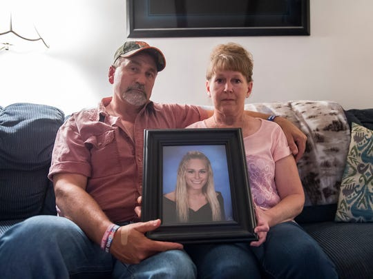 Rich and Shelia Craumer hold a portrait of their late daughter, Briana, inside their Spring Grove home. Briana battled a heroin addiction that claimed her life in December 2017. The Craumers have since started Bri's Hope, a monthly support group for those affected by addiction.