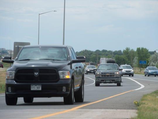 Northbound traffic on I-25 exits onto Harmony Road