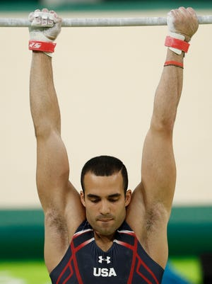 Danell Leyva practices on the uneven bars during training at Rio Olympic Arena.