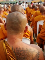 Monks gather to celebrate Buddha's birthday and the 60th anniversary of the King's accession to the throne, Bangkok, Thailand.