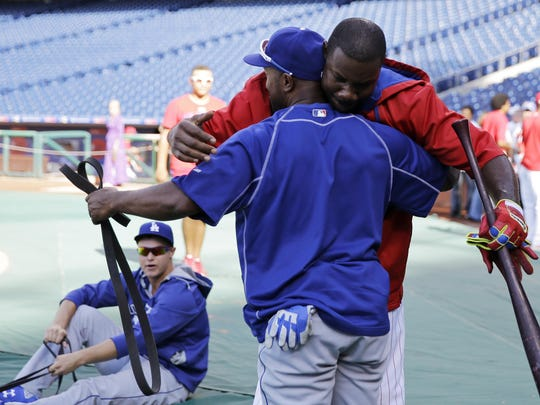 The Phillies' Ryan Howard (right) greets Jimmy Rollins, a former teammate and current Los Angeles Dodger, before a game Tuesday in Philadelphia.