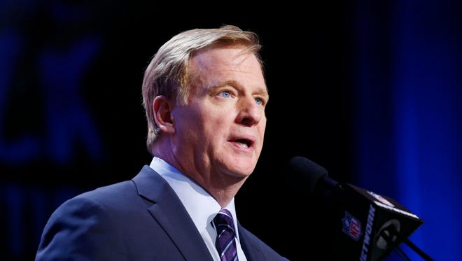 NFL Commissioner Roger Goodell announces a pick in the first round of the 2016 NFL Draft at Auditorium Theatre.
