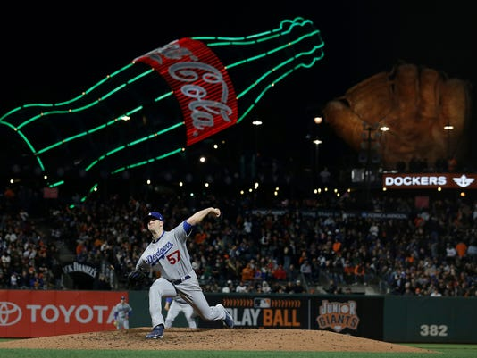 Los Angeles Dodgers pitcher Alex Wood throws against the San Francisco Giants during the fifth inning of a baseball game in San Francisco, Wednesday, April 26, 2017. (AP Photo/Jeff Chiu)