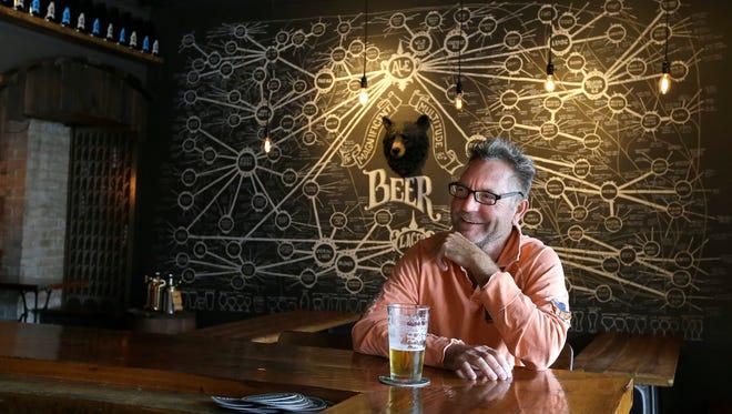 Dan Koller enjoys a beer at Draft & Vessel in Shorewood.