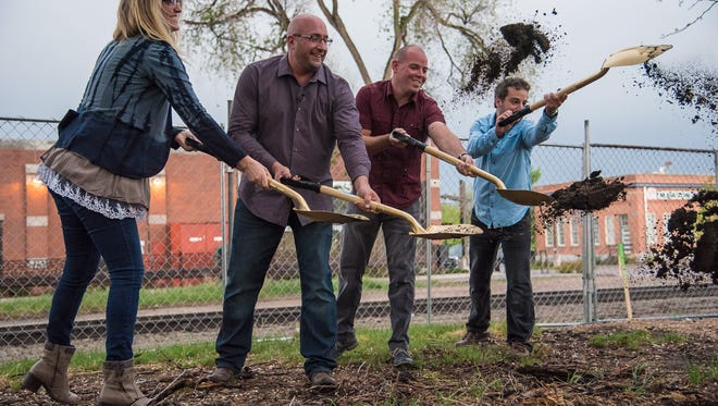The new owners of the former Jefferson Park, Ryan Houdek, Ty Fulcher and Raffi Jergerian, begin a breaking ground celebration for a new restaurant on Monday, May 8, 2017.