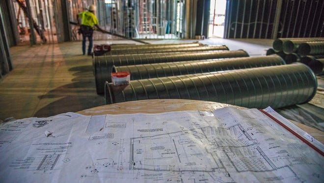 A blueprint of the new Lyric Cinema Cafe sits on a table in the area that will become the  largest of 3 theaters in the new building, located at 1209 N. College Ave., on Wednesday, June 28, 2017.   The 10,000 square foot building is tentatively scheduled to open in September.