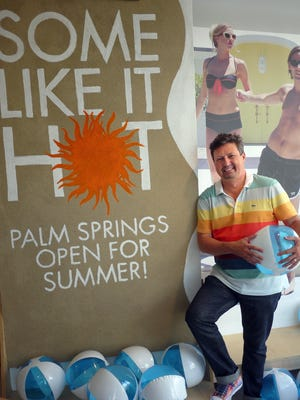 Larry Abel, founder and CEO of Raymond-Lawrence, stands beside his window displays reminding visitors that his Palm Springs shop, a retail incubator, is still open in summertime Friday, August 10, 2012.