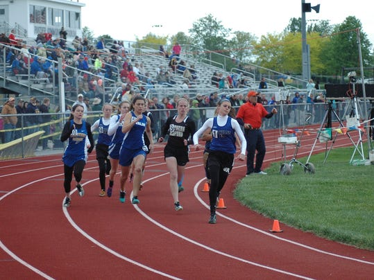 McConnellsburg s McKenzie Gelvin, far right, leads the pack in the 800 on Wednesday at the District 5 Championships. Gelvin captured gold in the event and earned silver in the 100 dash.