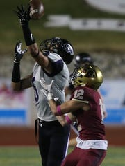 Franklin defender Elijah Ruiz deflects a pass away from El Dorado receiver Jorge Hernandez Thursday. It was incomplete.