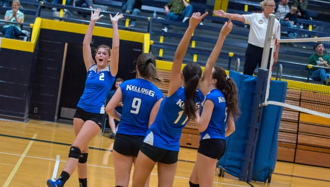 Kellogg Community College volleyball players celebrate a point during a match against Glen Oaks Community College on Sept. 7 at the Battle Creek Central Fieldhouse.
