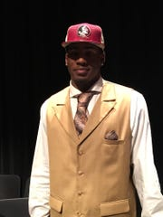 Brian Burns poses for a photo after joining FSU's 2016 recruiting class at Plantation American Heritage High School on Wednesday, Feb, 3, 2016.