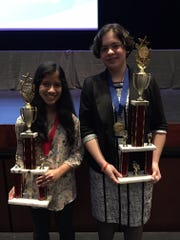 Ibnat Meah and Zoe Prats, winners of the junior high level of the York County Science and Engineering Fair, pose for a photo at the fair.