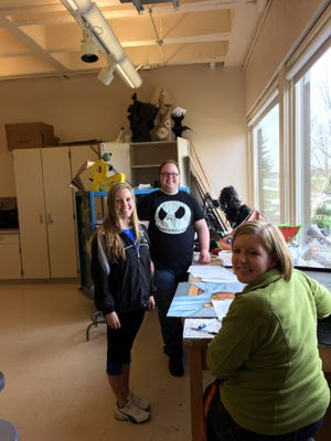 UW-Fond du Lac students (left to right) Aisha Ullius, Campbellsport; Kyle Arnold, Fond du Lac; and Amber Brown, Lomira, are preparing student artwork for the annual Art Momentum show and sale at the campus on May 6. The proceeds from this event support student scholarships at UW-Fond du Lac.