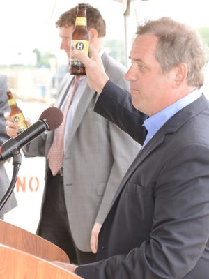 Hinterland Brewery owner Bill Tressler offers a toast during a groundbreaking ceremony Thursday in the Titletown District. June 16, 2016.
