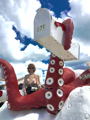 Kathleen Even returns to her Isles of Capri home after being off island for the day to find that her beloved octopus mailbox had been damaged.