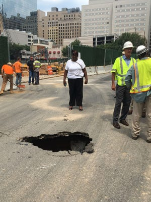 A sinkhole closed the 800 block of N. Shipley St. Thursday after a dump truck became stuck in it, according to Wilmington police.