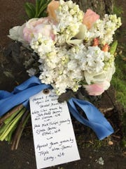 This April 23, 2016 photo provided by Debra Prinzing of Slowflowers.com shows a bouquet designed by Prinzing showing a tag sharing details about each flower she included in this arrangement. She wrote the tag for bride as a way to personalize the connection between celebration flowers and the local farmers who grew each bloom. (Deborah Prinzing via AP)