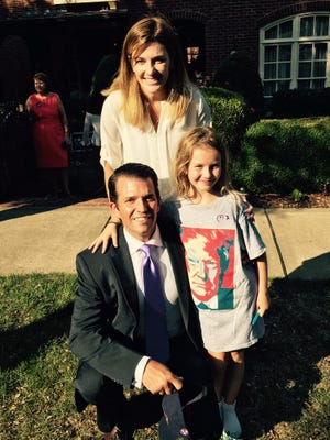Donald Trump Jr. poses for a photo with Amber Conrad and daughter Aislyn Conrad before departing a campaign fundraiser in Franklin on Wednesday for his father, Republican presidential candidate Donald Trump.