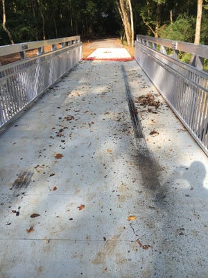 The new walking bridge on Murfreesboro's greenway near the Walter Hill community was vandalized.