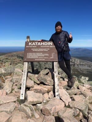 Alex Taylor stands atop Mount Katahdin, Maine, the northern terminus of the Appalchian Trail, on Sept. 30, 2016.