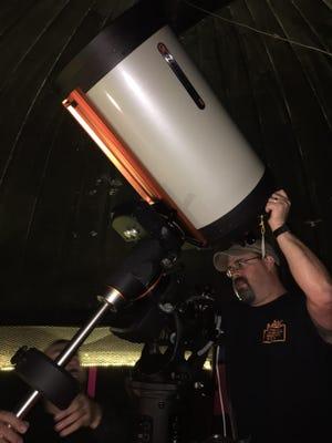 Patrick Manley of the Kopernik Astro Society installs Kopernik's newest telescope.