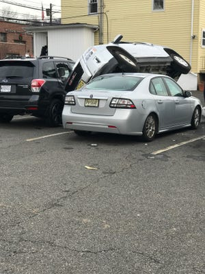 The driver of this GMC SUV took a short cut from one downtown Millburn parking lot to another.