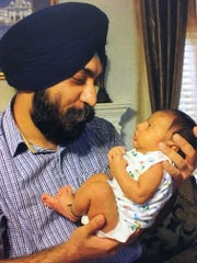 Vaneet Singh holds his son, Anhad Singh, in an undated family photo.