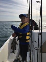 Alex shows off a nice grouper that gave him a battle!