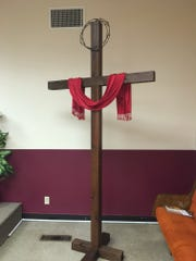 A large, handmade cross sits in the corner of the sanctuary at Journey Baptist Church of North Texas. For about five months, church members met in the home of Charl and Tommy Bragg until moving into the old Carpenter's Union Hall on Jacksboro Highway in late 2015.