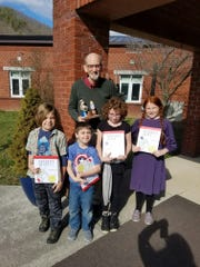 Don Harris stands with Hot Springs Elementary School students Julian Lafond, Levi Shultz, Bobbie Reume and Kristen Reese.