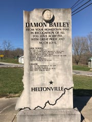 A monument honoring Damon Bailey stands next to an abandoned school in Heltonville, Indiana.