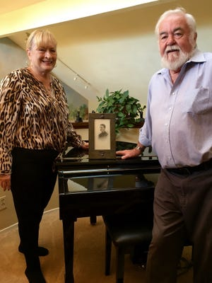 Linda and Graham Richards pose in their Simi Valley home with the portrait of British Lt. William Furse which they plan to return to his hometown. Furse, of Moseley, England, died in combat in World War I.