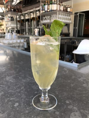The Clarified Milk Punch is one of four featured drinks at the craft cocktail dinner at The Continental