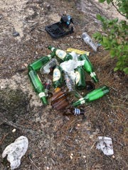 Some of the trash left behind at a state-owned quarry on Piney Hollow Road in Winslow, where alcohol consumption is prohibited.