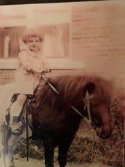 Three-year-old equestrian Estell on a pony in Brooklyn in 1920.