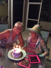 Estell caught a break on this cake -- a candle for every decade.