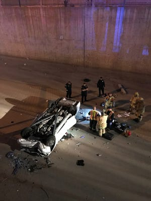 A car flipped into a dry canal in Phoenix on Wednesday evening.