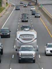 Traffic heads north on I-75/US 23 through Flint on