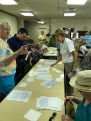 Volunteers gather at St. Lucas United Church of Christ during Gerrymander Meander on Monday.